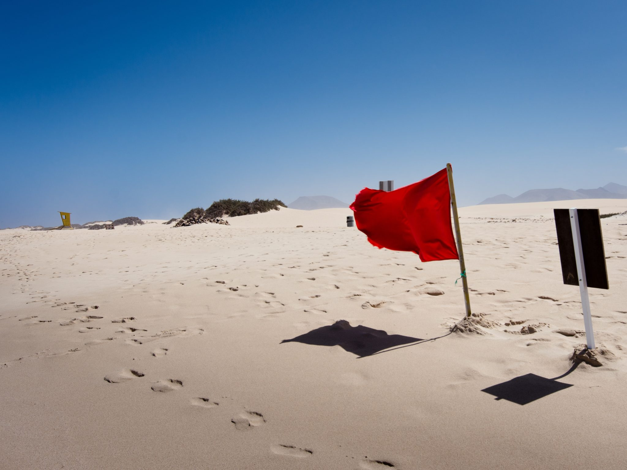Red flag in the sand